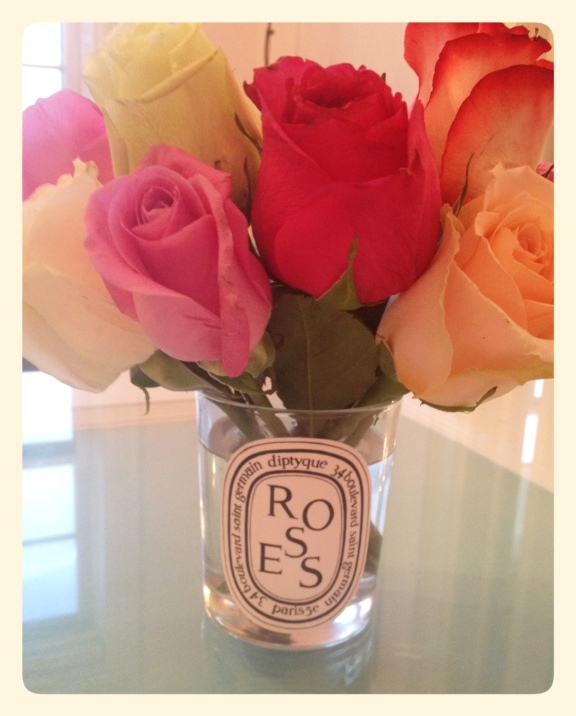 Multicoloured roses in Diptyque candle vase